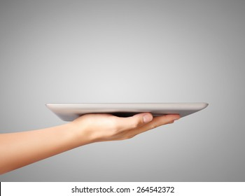 man hand using tablet computer, looking real estate