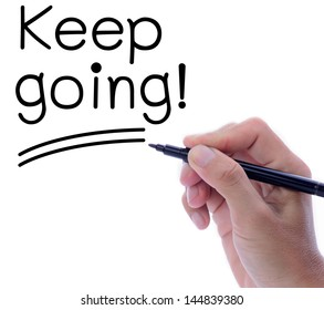 Man hand writing word, Keep going, in motivation concept