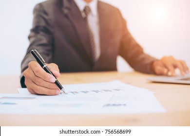 man hand writting on a paper in office business concept vintage tone
