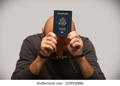 Man in handcuffs with American passport