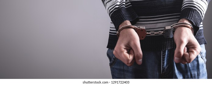 Man in handcuffs. Criminal concept
