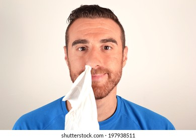 Man with handkerchief in the nose