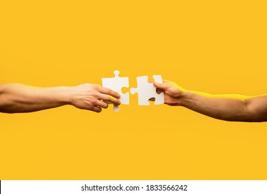 Man hands connecting couple puzzle piece. Business solutions, target, success, goals and strategy concepts. Hand connecting jigsaw puzzle. Business solutions, success and strategy concept.