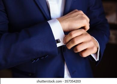 Man hands with cufflinks. Elegant gentleman clother