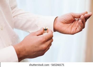 Man hands with cufflinks. Elegant gentleman clothes