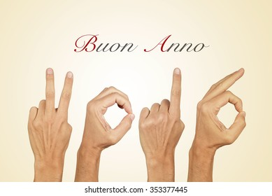 man hands forming the number 2016, as the new year, and the text buon anno, happy new year in italian, on a beige background