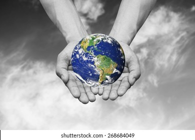 man hands gesture holding the color global for save the word from greenhouse effect concept:Elements of this image furnished by NASA