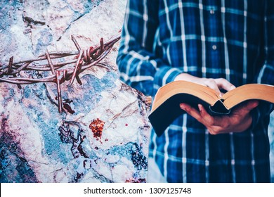 man hands hold and reading bible with crown of throne with red blood on the rock , Christian conceptual image point to the sacrifice of Jesus  that show in holy bible verses, Easter background.