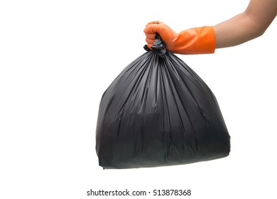 man hands holding black garbage bag isolated on white background