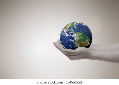 man hands holding circle world for save earth life concept.Elements of this image furnished by NASA