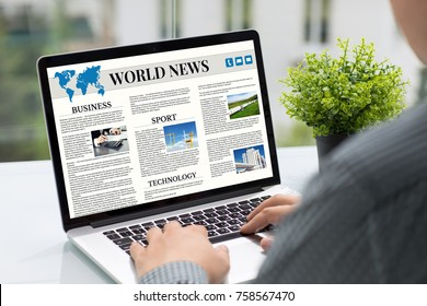 Man hands holding computer with app world news screen in cafe
