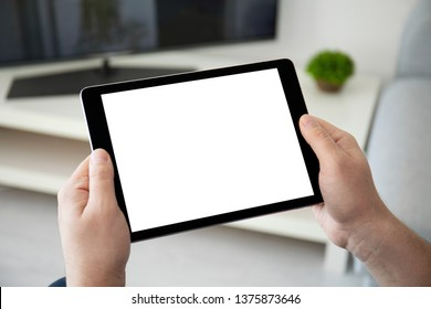 man hands holding computer tablet with isolated screen in the home room