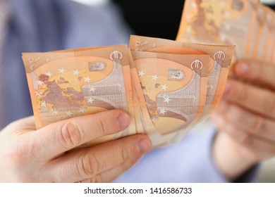 Man Hands Holding Euro Savings Finance Concept. Businessman with Roll of Money Banknotes Closeup Photo. Financial Cash Income Accounting. Business Expenses and Profit. Banking System