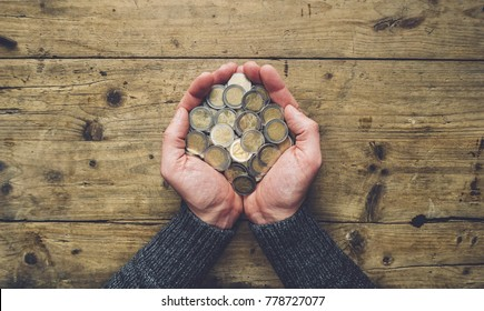 man hands holding a heap of euro coins banner background, top view, with copy space