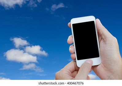 Man hands holding mobile smartphone with blue sky background, digital alarm concept, cloud storage concept.