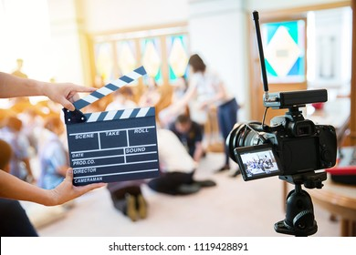 Man hands holding movie clapper.Film director concept.camera show viewfinder image catch motion in interview or broadcast wedding ceremony, catch feeling, stopped motion in best memorial day concept.