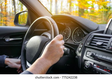Man hands holding steering wheel