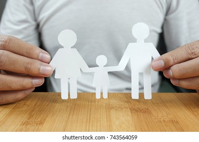Man hands holding white paper family - family concept