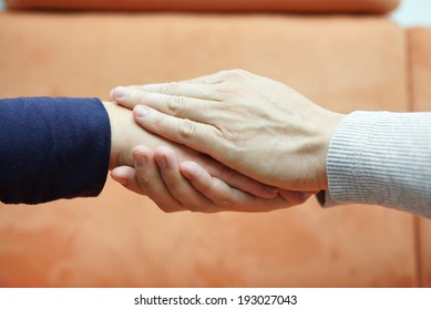 man hands holding  woman hand from both sides. Compassion and  concern concept