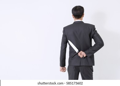man hands with knife on a white background. / Young businessman working