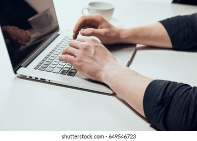 Man hands with a laptop