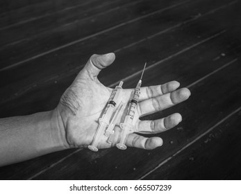 Man hands in need of syringes. When the needle is in hand, it's like he has to do something.
