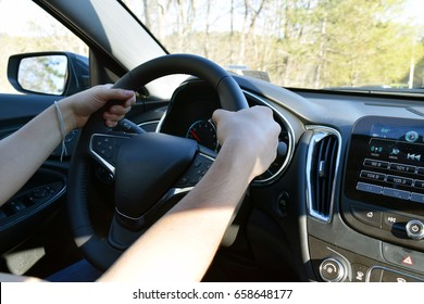 Man with hands on driving wheel in car