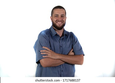 Man with hands on hips on white background