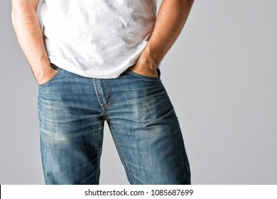 Man with hands on his jeans pockets