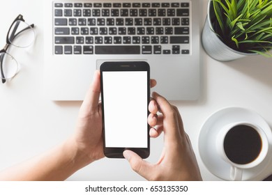 Man hands on smartphone on desk / blank screen