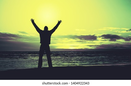 man with hands up on a sunset, prayer or request to heaven