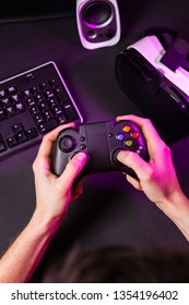 Man hands playing a computer game with a game joystick.
