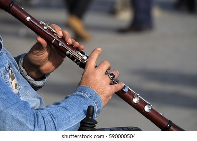 Man Hands Playing Wooden Clarinet