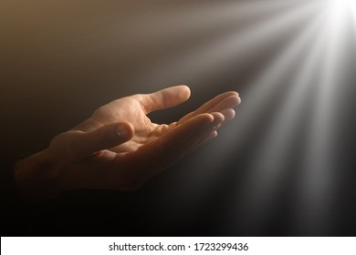Man hands praying in dark background
