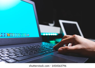 man hands pressing on laptop computer keyboard. technology concept