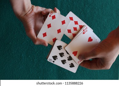 Man hands show poker cards. magician does a trick