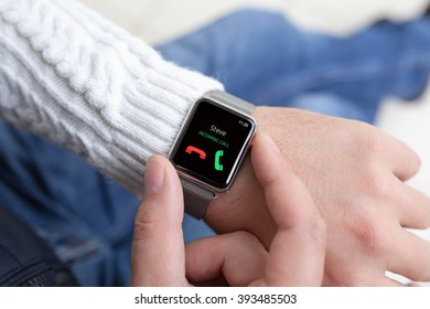 man hands and smart watch with call on the screen
