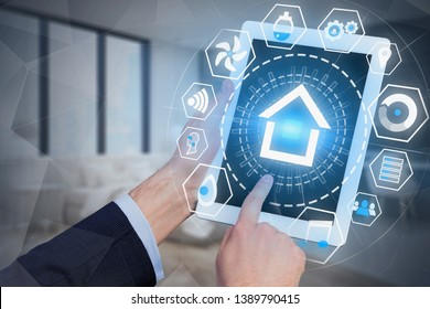 Man hands with tablet computer using smart home HUD interface over blurred bedroom background. Toned image double exposure