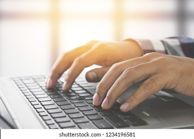 Man hands typing on a laptop keyboard on a desk, Website developer, people and technology concept