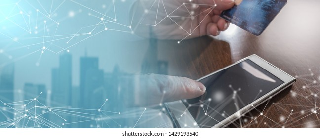 Man hands using smartphone and credit card for online payment; multiple exposure