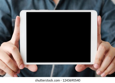 Man hands using tablet with blank screen for mock up template background, business technology and lifestyle background concept
