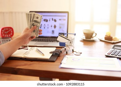 Man hands using tablet, laptop and holding credit card and cash  on line shop and Book air ticket