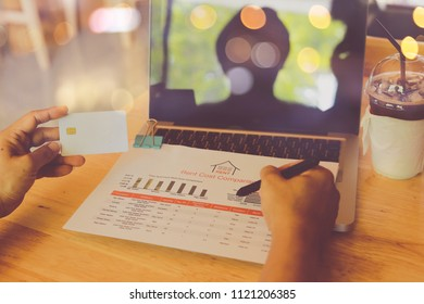 Man hands using tablet, laptop and holding credit card on line shop and Book air ticket (shopping online cradut crad holiday concept)