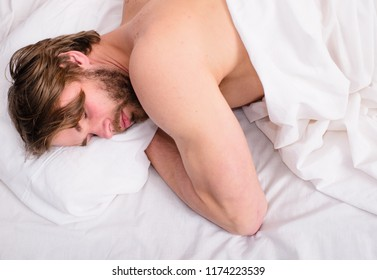 Man handsome guy sleep nap on bed top view. Man sleepy unshaven bearded face has rest. Comfortable mattress and pillows. Time for nap. Deep sleep concept. Let your body feel comfortable.