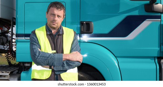 man handsome truck driver with truck behind