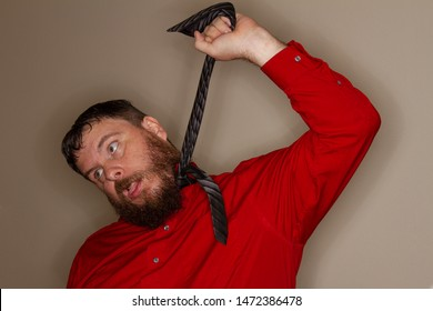 man hanging himself with his tie while at work