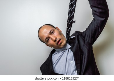 Man hanging himself with the tie