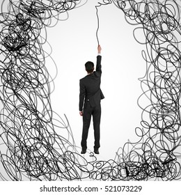 Man hanging on abstract scribbled rope. Maze and business challenge concept