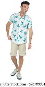 Man is happy and laughs happily. Natural and spontaneous. Brazilian male wearing a Hawaiian style floral shirt and beige shorts. Summer, tropical.