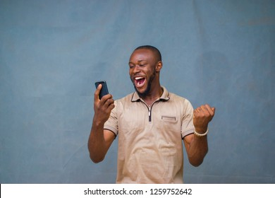 Man happy over what he's seeing on his phone